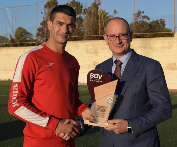 Victoria Hotspurs defender Ferdinando Apap (left) receives the monthly award from Horace Laudi, the BOV Chief Officer.