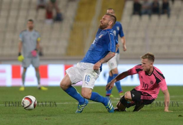 Italy's Daniele De Rossi (left) is tackled by Scotland's Matt Richie during their friendly football match at the National Stadium in Ta' Qali on May 29. Photo: Matthew Mirabelli