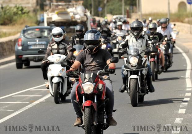 Motorcyclists accompany the funeral cortege of former policeman Christopher Paul Abela on June 13. Photo: Chris Sant Fournier