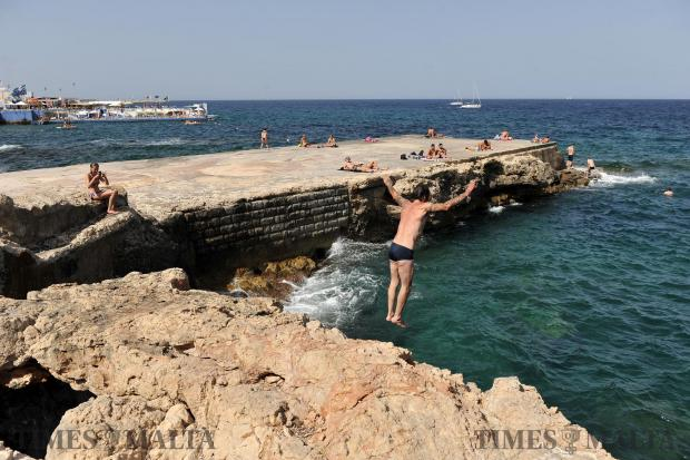 A man jumps into the sea near the Chalet in Sliema on July 1. Photo: Chris Sant Fournier
