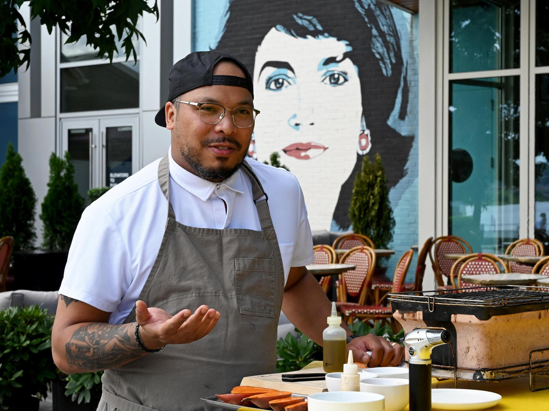 Executive chef Jerome Grant speaking about African American cuisine, its origins, ingredients and influence on American cuisine during a cooking demonstration in front of the American bistro Jackie in Washington, DC.