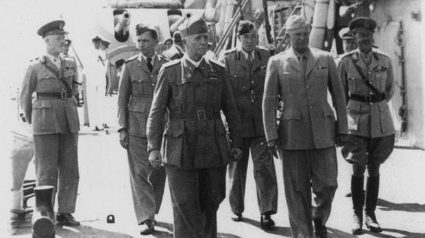 The group of VIPs walking along the deck of the battleship Nelson on their way to sign the final armistice agreement. They are (from left) Governor of Malta Lord Gort, Air Chief Marshal Arthur Tedder, Marshal Pietro Badoglio, Lt General Noel Mason-MacFarlane, General Dwight Eisenhower, Commodore Royer Dick (face only) and General Harold Alexander. Photos: National War Museum Association