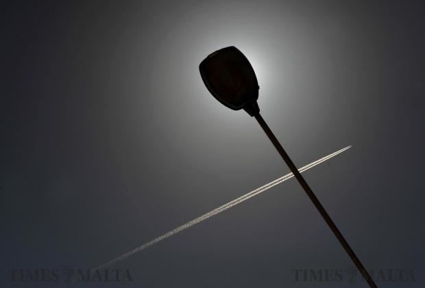 A high flying aircraft streaks across the sky on April 18. Photo: Chris Sant Fournier