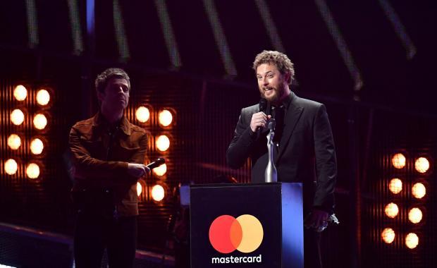 Duncan Jones accepts an award on behalf of his dad David Bowie.