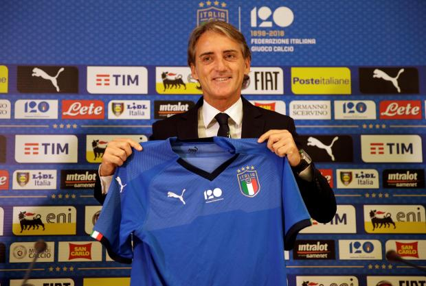 New coach Roberto Mancini poses with the Italy shirt.