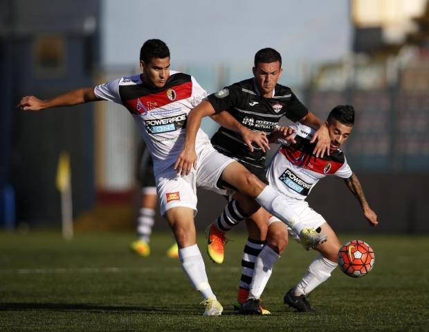 Balzan's Lydon Micallef (centre) powers his way through Louis Vergara and Luke Sciberras of Hamrun Spartans during their Premier League football match at the Tedesco Stadium in Hamrun on October 22. Photo: Darrin Zammit Lupi