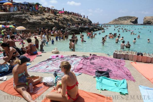 Bathers enjoy Blue Lagoon at Comino in ease with ample of space to relax after unwanted deckchairs crowding the area were removed by MTA officials on August 17. Photo: Steve Zammit Lupi
