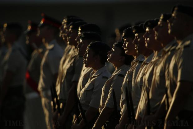 Armed Forces of Malta soldiers take part in their passing-out parade after several weeks of basic military training at Luqa Barracks on August 10. Photo: Darrin Zammit Lupi