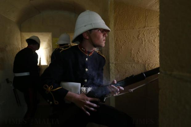 A National Heritage Trust historical re-enactor looks out of a gun port after firing his rifle during a re-enactment of Victorian-era British Army garrison life at the Fort Rinella coastal battery, built in 1878, in Kalkara on April 27. Photo: Darrin Zammit Lupi