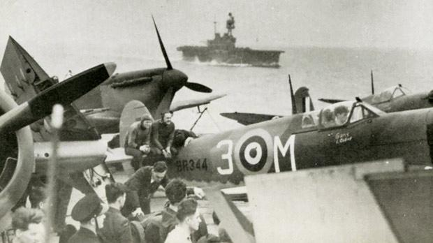 Spitfires on the flight deck of USS Wasp with the British carrier HMS Eagle in the background.Photo: The Air Battle for Malta, James Douglas-Hamilton