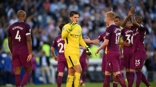 Manchester City's Ederson Moraes celebrates after the match with Kevin De Bruyne.