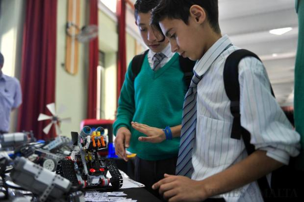 Students examine a robot during the Science and Tech exhibition held at St. Clara Secondary School in Pembroke on April 20. Photo: Steve Zammit Lupi