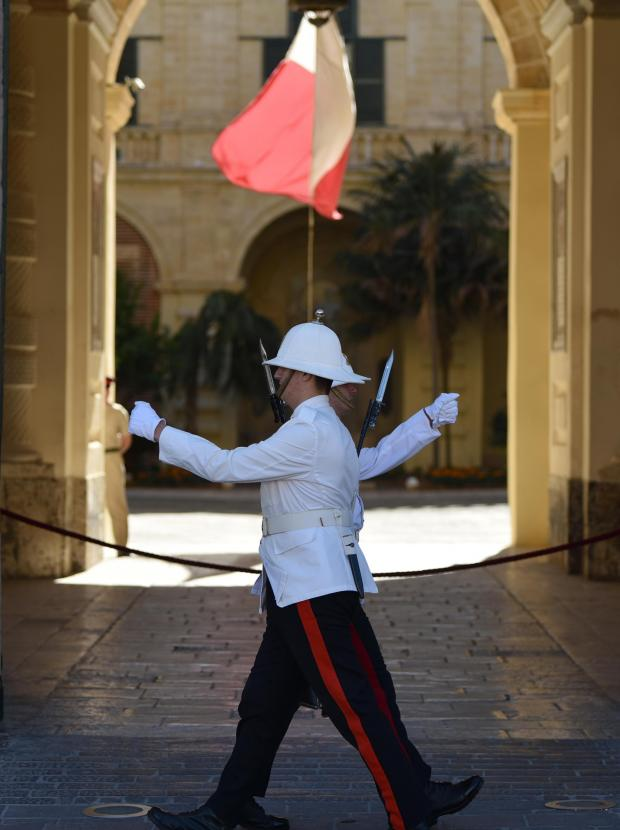Two armed forces guards march past each other at the Grand Masters Palace in Valletta on October 24. Photo: Mark Zammit Cordina