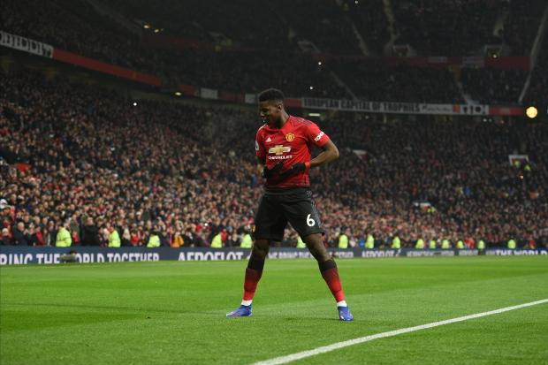 Man. United's Paul Pogba celebrates his goal with a 'cradle rocking' celebration.