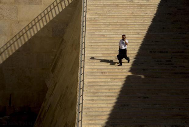 Transport Minister Joe Mizzi makes his way to parliament in Valletta on July 14. Photo: Darrin Zammit Lupi