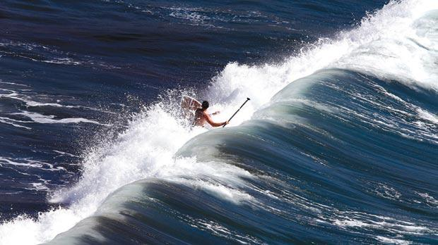 A man riding the waves while practising stand-up paddle surfing at Għajn Tuffieħa Bay is captured in this image, one of more than 150 taken by Times of Malta photographers and featured in the 2013 Times Picture Annual. Photo: Darrin Zammit Lupi