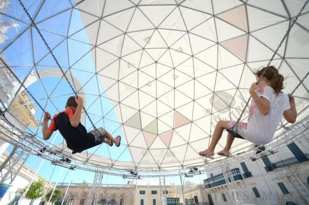 Children enjoy Bandli, a swing installation and collaboration between the Malta Arts Festival and the Modern Music Days concert series of Teatru Manoel in St George's Square Valletta on July 18. Photo: Matthew Mirabelli