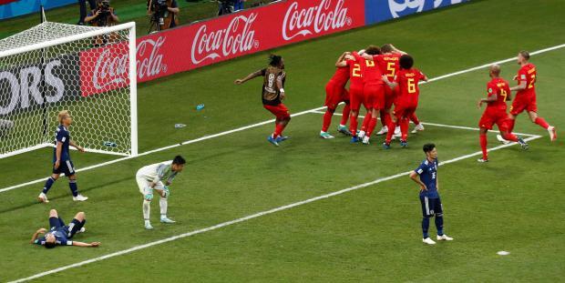 Belgium's Nacer Chadli celebrates scoring their third goal with team mates.