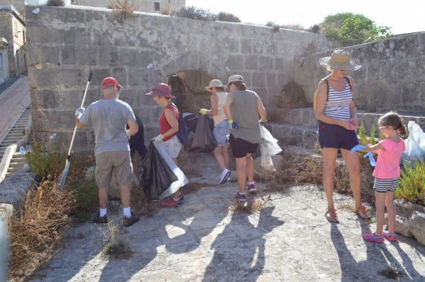 Volunteers clean up St Helen's Gate in Cospicua.