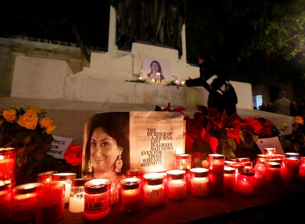Tributes to Daphne Caruana Galizia at the foot of the Great Siege Memorial in Valletta during the vigil on Sunday. Photo: Reuters.