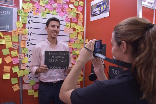 A criminology student takes a mug shot photo of a student during Freshers' Week at the University of Malta in Tal-Qroqq on October 4. Photo: Mark Zammit Cordina