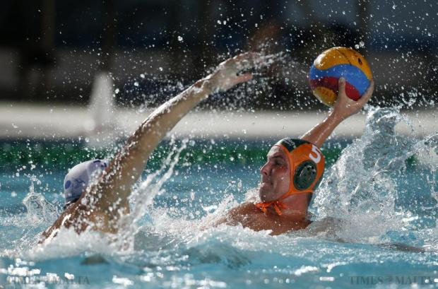 Marsaxlokk's Milos Korolija tries to block a shot from Marsascala's Bela Torok (right) during their First Division waterpolo match at the National Pool in Tal'Qroqq on August 19. Photo: Darrin Zammit Lupi
