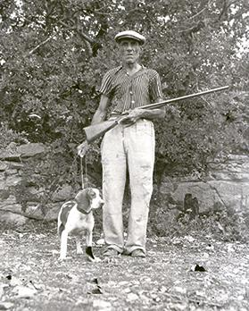 A hunter and dog glass plate.