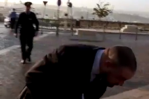 Watch: Justice Minister gets egged by protesters outside Castille
