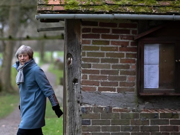 Britain's Prime Minister Theresa May leaves after attending a church service, near her Maidenhead constituency, west of London on Sunday.