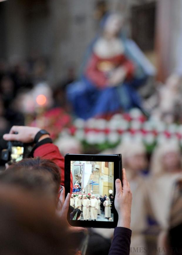 A woman photographs the statue with her tablet at the procession of Our Lady of Sorrows in Valletta on March 18. Photo: Chris Sant Fournier