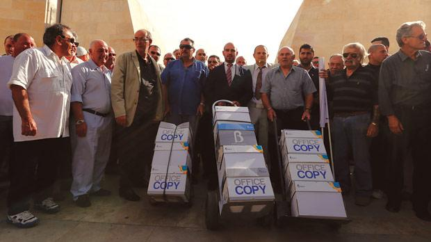 Boxes filled with petition forms at City Gate and, right, being taken into Parliament yesterday afternoon.