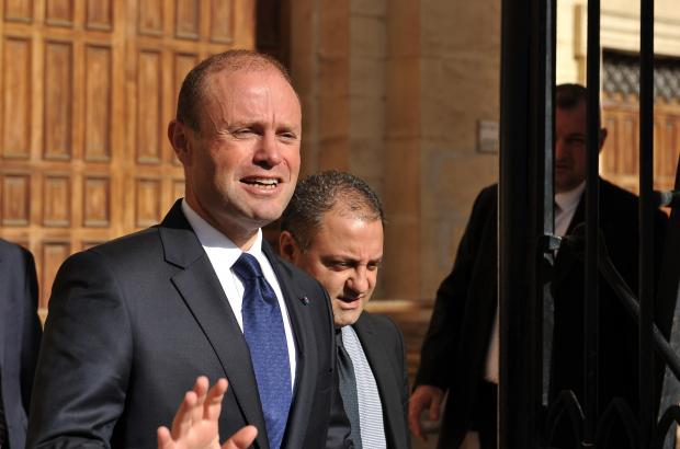 Joseph Muscat and Kurt Farrugia leaving court last month.