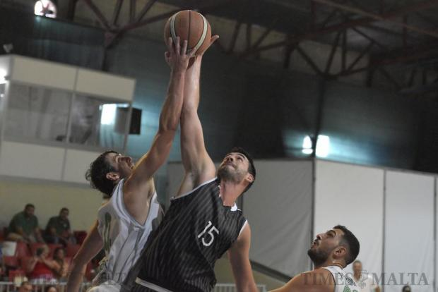 Chad Patus of Floriana and Alvaro Alarcon of Hibernians attempt to take the ball during their basketball match at the Ta' Qali Pavillion on October 9. Photo: Mark Zammit Cordina