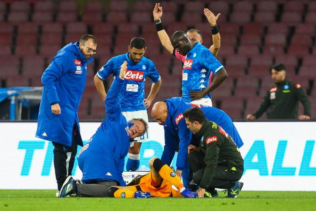 Napoli goalkeeper David Osina receives treatment after collapsing on the pitch against Udinese.
