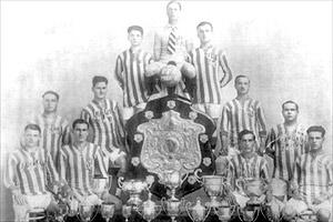 Floriana with the Cousis Shield they won in 1922-23 and other trophies in their impressive collection. Back row: Salvu Grima, Emmanuel Azzopardi, Harry Samuel. Centre: Guzi Alamango, George West, Carmelo Zammit, Salvu Tabone. Front: Jack Herbert, John Tabone, Guzi Micallef, Gejtu Psaila.