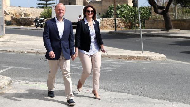 "Dr and Mrs Muscat approach the polling station. P<div id=""_tag_719033"" class="" bbcode_attach bbcode_attach_left bbcode_attach_large""><img src=""https://cdn-attachments.timesofmalta.com/e6c3db8633d863efe075c5978a2084ecb8d4b29b-1558783429-5ce925c5-620x348.jpg"" title=""President Vella (centre) and his wife Miriam (right) vote in Żejtun. Photo: DOI/Kevin Abela"" alt=""President Vella (centre) and his wife Miriam (right) vote in Żejtun. Photo: DOI/Kevin Abela"" /><span>President Vella (centre) and his wife Miriam (right) vote in Żejtun. Photo: DOI/Kevin Abela</span></div>Photo: DOI/Reuben Piscopo"