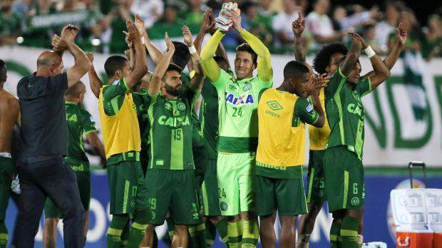 Players of Chapecoense celebrate after their match against San Lorenzo at the Arena Conda stadium in Chapeco, Brazil, November 23.