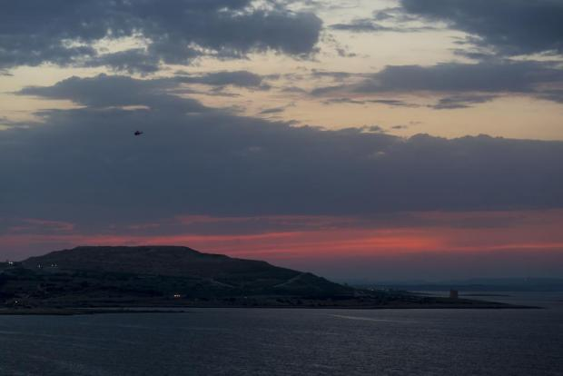An Armed Forces of Malta helicopter flies over Bahar ic-Caghaq at dusk on August 18. Photo: Darrin Zammit Lupi