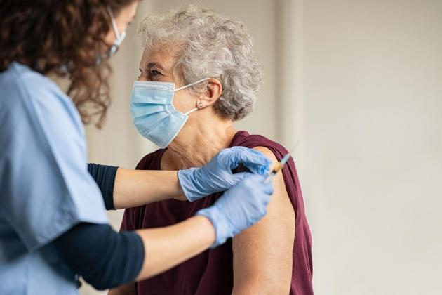 What proportion of over 80s have received a COVID-19 vaccine?