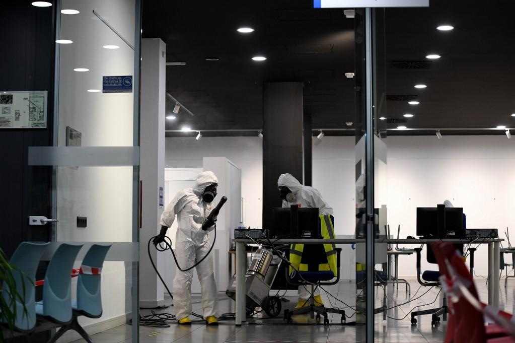 Spanish army members disinfect the Lope de Vega cultural centre, located in the Entrevías district of Madrid. Photo: AFP