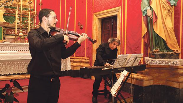 Violinist Pierre Louis Attard and his father Colin during the concert. Photos: Charles Spiteri