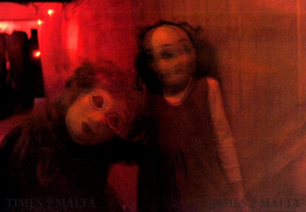 Two girls wearing a masks intend to spook people in a horror house in Swieqi on Halloween on October 31. Photo: Chris Sant Fournier