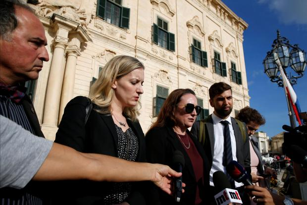 The media delegation members talk to the media after talks with Joseph Muscat. Photo: Reuters