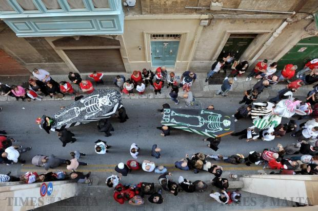 Coffins representing rival football teams are carried through the streets of Valletta as part of a mock funeral organised by Valletta supporters on May 6. Photo: Chris Sant Fournier