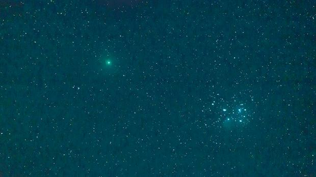 Comet 46P/Wirtanen, which made a close approach to earth last December, is seen passing by the Pleiades star cluster.