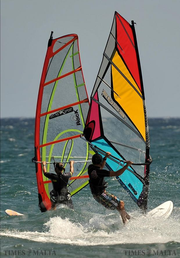 Windsurfers cross each other at Ghallis on September 3. Photo: Chris Sant Fournier