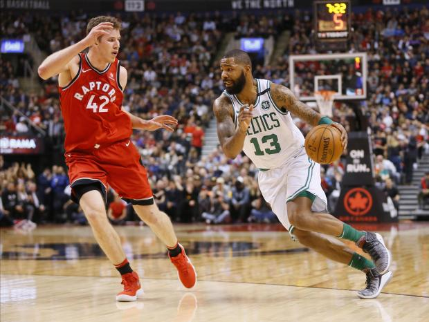 Boston Celtics forward Marcus Morris (13) drives to the net against Toronto Raptors center Jakob Poeltl (42) at the Air Canada Centre. Toronto defeated Boston. Photo Credit: John E. Sokolowski-USA TODAY Sports