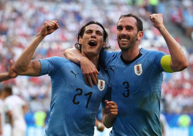 Edinson Cavani celebrates with Diego Godin at the end of the match.