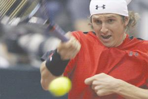 Russia`s Igor Andreev hits a return against Philipp Kohlschreiber, of Germany, yesterday.