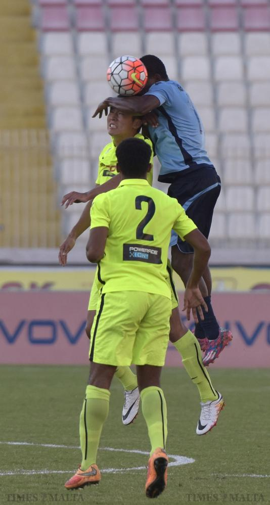 Sliema Wanderers' Wisdom Salomon jumps over St Andrews' Wong Bon Che during their Premier League football match at the National Stadium in Ta' Qali on September 21. Photo: Mark Zammit Cordina